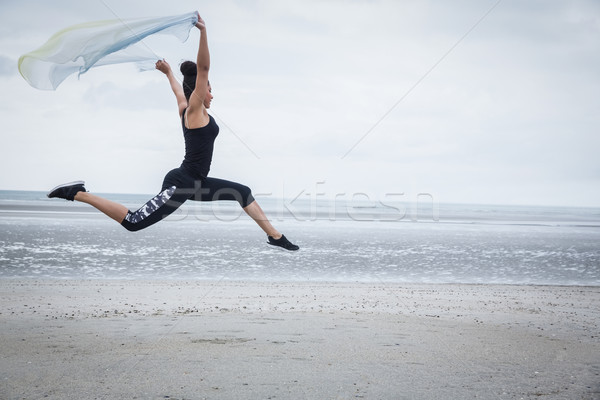 Fit girl leaping with scarf  Stock photo © wavebreak_media