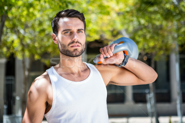 Handsome athlete outfit with a kettlebell Stock photo © wavebreak_media