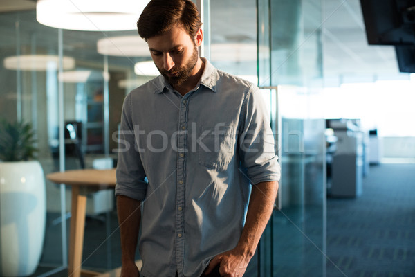 Uphappy businessman looking down Stock photo © wavebreak_media