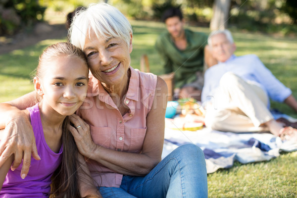 Portrait of grandmother and granddaughter sitting in the park Stock photo © wavebreak_media