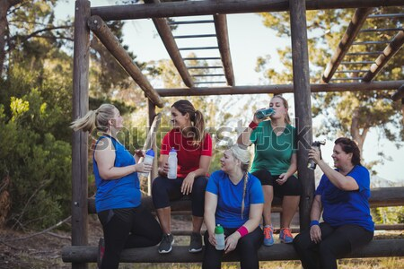 Female trainer instructing women to climb a rope in the boot camp Stock photo © wavebreak_media