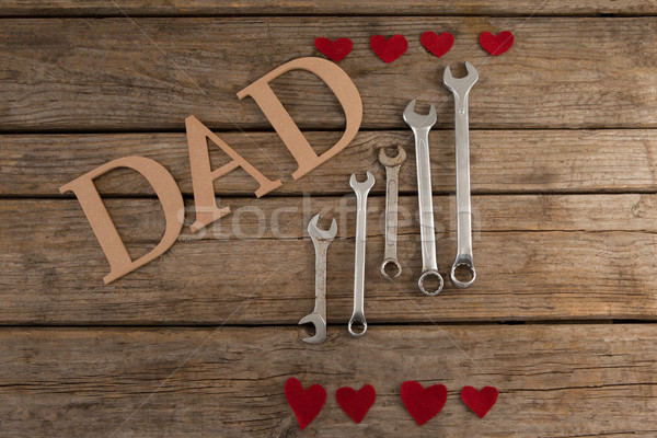 Dad text by wrenches and heart shapes on table Stock photo © wavebreak_media