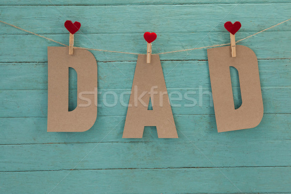 Dad text with cloth pegs hanging on rope Stock photo © wavebreak_media