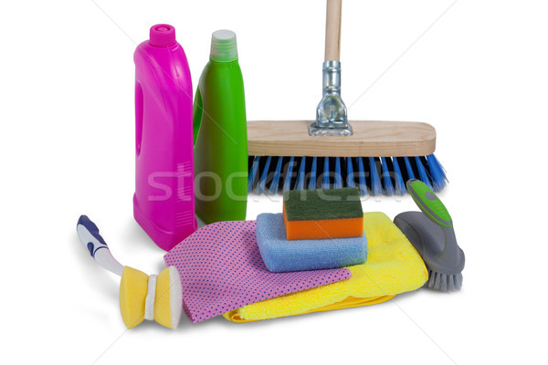 Detergent containers, scouring pad, towel, napkin cloth and floor mop on white background Stock photo © wavebreak_media