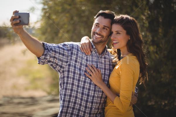 Smiling young couple taking selfie at olive farm Stock photo © wavebreak_media