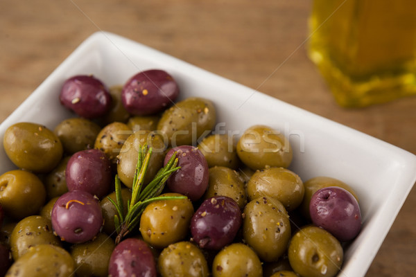 Close up of olives with rosemary served in bowl Stock photo © wavebreak_media