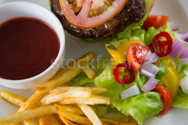 Overhead view of salad with burger and french fries Stock photo © wavebreak_media