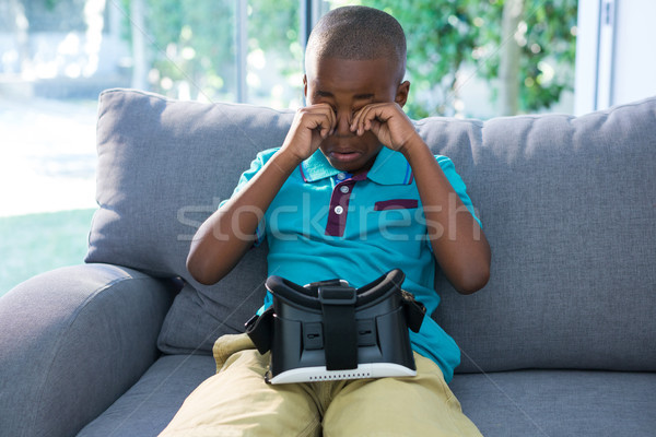 Menino olhos sessão fone sofá sala de estar Foto stock © wavebreak_media