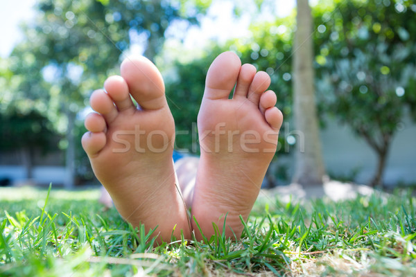 Low section of girl relaxing in yard Stock photo © wavebreak_media