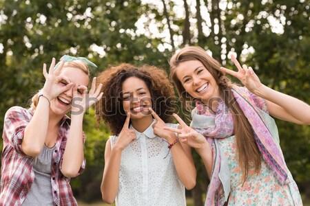 Portrait of smiling friends against trees Stock photo © wavebreak_media