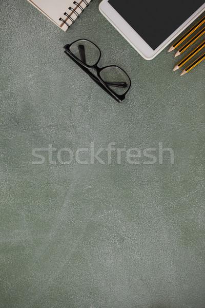 карандашом цифровой таблетка очки книга доске Сток-фото © wavebreak_media