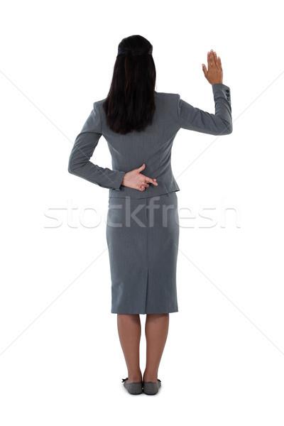 Businesswoman raising her hand Stock photo © wavebreak_media
