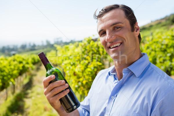 Portrait of smiling vintner examining wine Stock photo © wavebreak_media