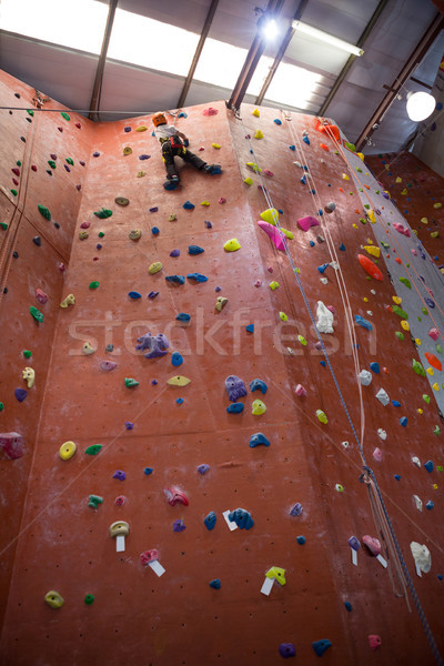 Determined boy practicing rock climbing Stock photo © wavebreak_media