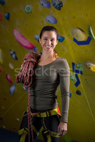 Happy woman with rope in fitness studio Stock photo © wavebreak_media