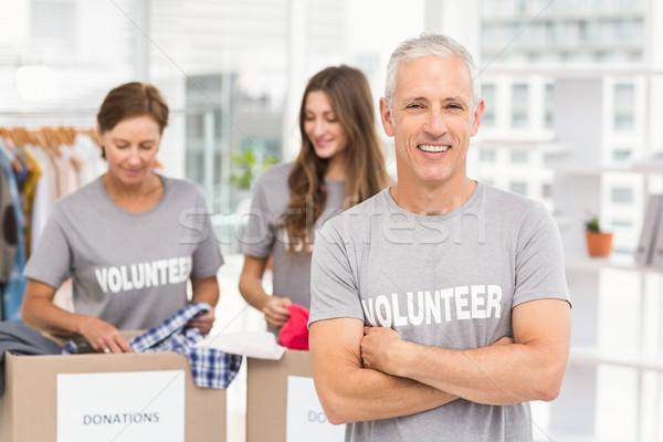 Mosolyog önkéntes keresztbe tett kar portré iroda üzlet Stock fotó © wavebreak_media