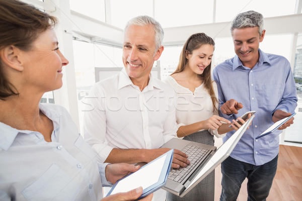 Business people using several electronic devices Stock photo © wavebreak_media