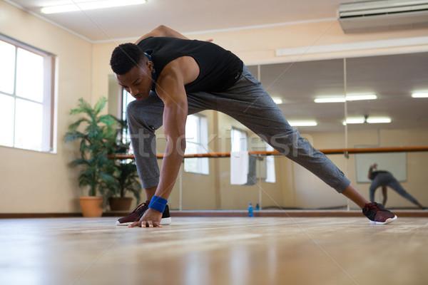 Full length of male dancer rehearsing on floor Stock photo © wavebreak_media