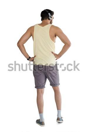 Man with headphones standing with hand on hip Stock photo © wavebreak_media
