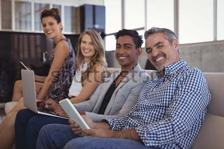 Smiling woman taking selfie with friends from digital tablet at coffee shop Stock photo © wavebreak_media