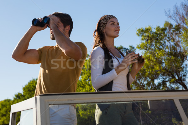 Couple using binoculars in off road vehicle Stock photo © wavebreak_media