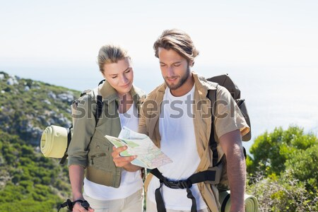 Couple reading map on off road vehicle with tire Stock photo © wavebreak_media