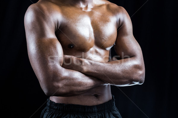 Mid section of shirtless athlete standing with arms crossed Stock photo © wavebreak_media