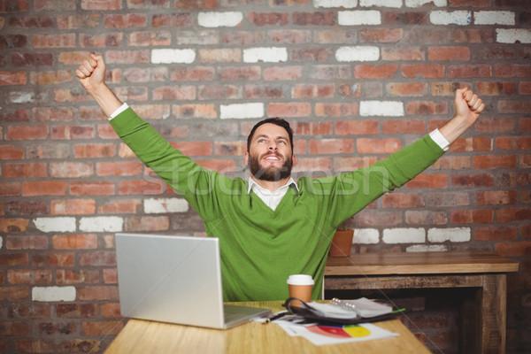 üzletember karok a magasban iroda ül kreatív üzlet Stock fotó © wavebreak_media