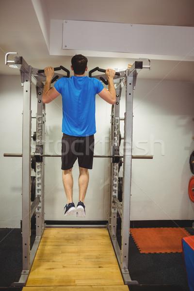 Fitt férfi húzás sport fitnessz egészség Stock fotó © wavebreak_media