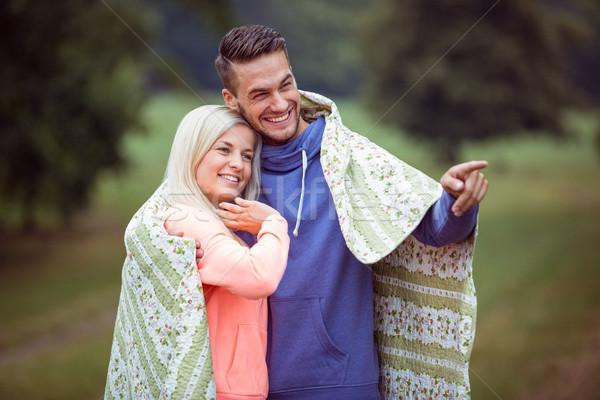 Happy couple hugging under blanket Stock photo © wavebreak_media