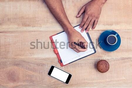 Man schrijven dagboek tabel koffiekopje cake Stockfoto © wavebreak_media