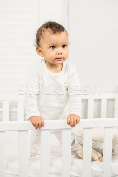 Stock photo: Cute baby standing in the crib