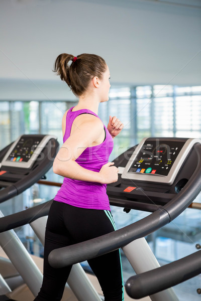соответствовать брюнетка работает бегущая дорожка спортзал женщину Сток-фото © wavebreak_media