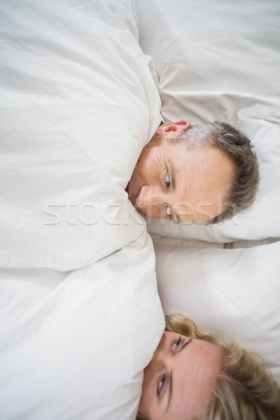 Cute couple cuddling in bed Stock photo © wavebreak_media