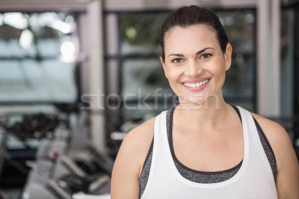 Woman smiling in sportswear Stock photo © wavebreak_media