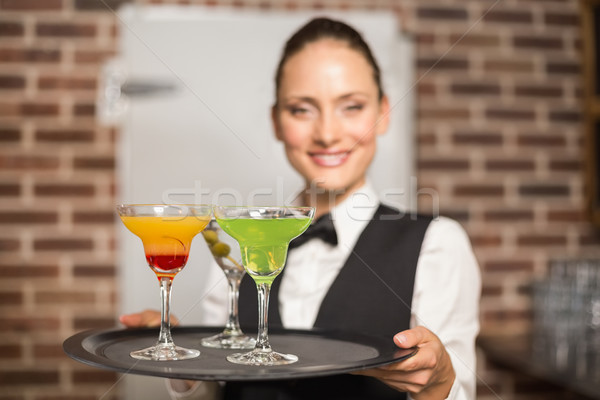 Barmaid holding plate with cocktails Stock photo © wavebreak_media