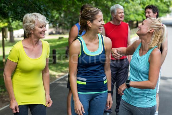 Maratón femenino atletas riendo junto parque Foto stock © wavebreak_media