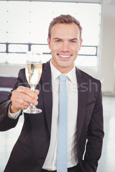 Portrait of businessman holding champagne flute Stock photo © wavebreak_media
