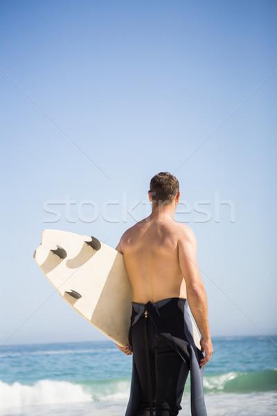 ハンサムな男 サーフボード ビーチ 男 海 ストックフォト © wavebreak_media