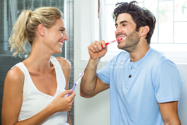 Couple brushing their teeth in bathroom Stock photo © wavebreak_media