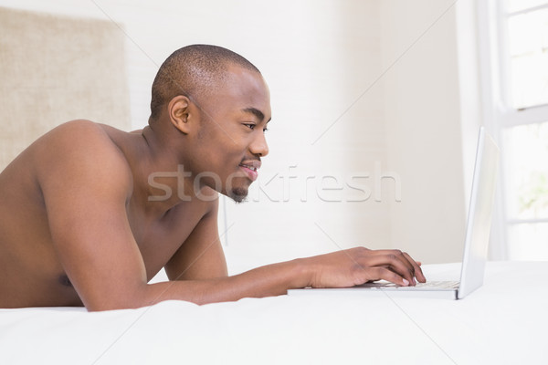 Young man using a laptop Stock photo © wavebreak_media