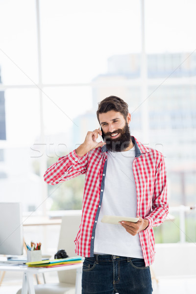 Hipster man calling someone Stock photo © wavebreak_media