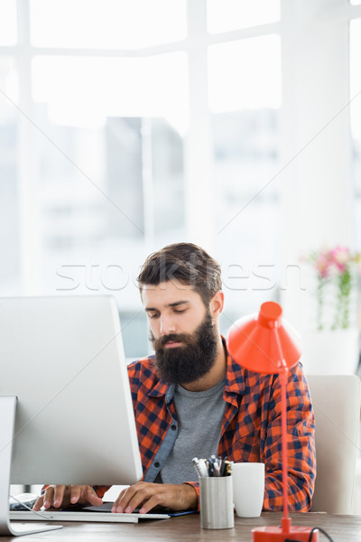 An hipster man is working on his computer Stock photo © wavebreak_media