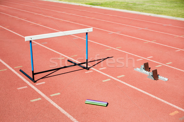 Hurdle, relay baton and a starting block kept on a running track Stock photo © wavebreak_media