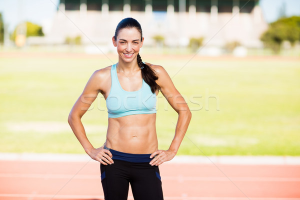 Portrait of female athlete standing with hands on hips Stock photo © wavebreak_media
