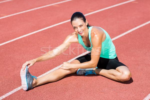Portrait of female athlete stretching her hamstring Stock photo © wavebreak_media