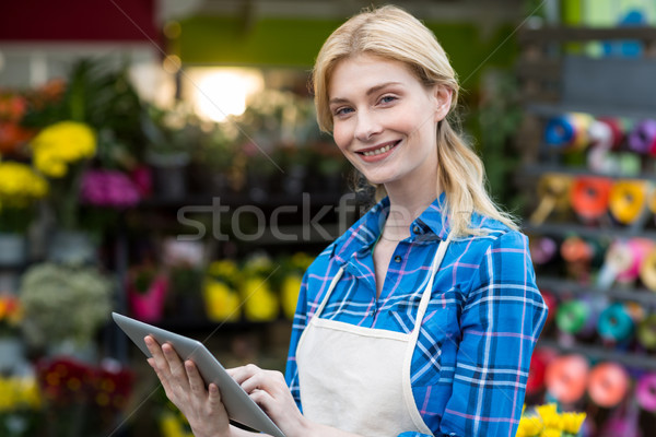 Smiling female florist using digital tablet Stock photo © wavebreak_media
