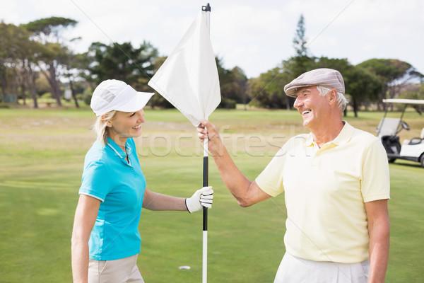 счастливым гольфист пару белый флаг Сток-фото © wavebreak_media