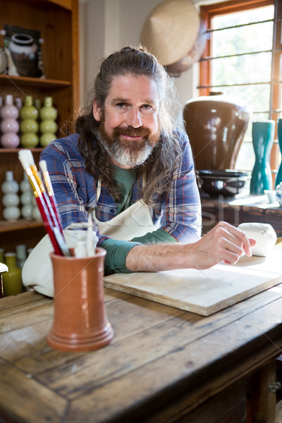 Portrait Homme poterie atelier table Photo stock © wavebreak_media