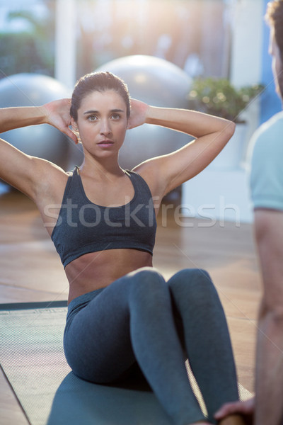 Physiotherapist assisting a female patient while exercising Stock photo © wavebreak_media